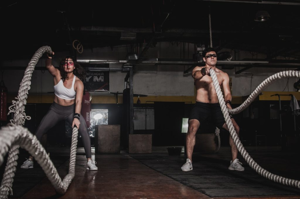 man-and-woman-holding-battle-ropes-1552242